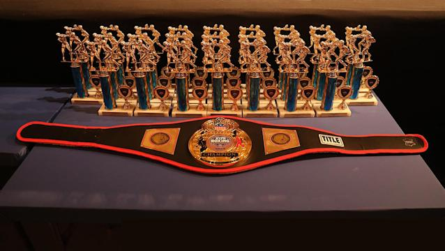 <p>The belt and trophies awarded for the NYPD Boxing Championships at the Theater at Madison Square Garden on June 8, 2017. (Photo: Gordon Donovan/Yahoo News) </p>