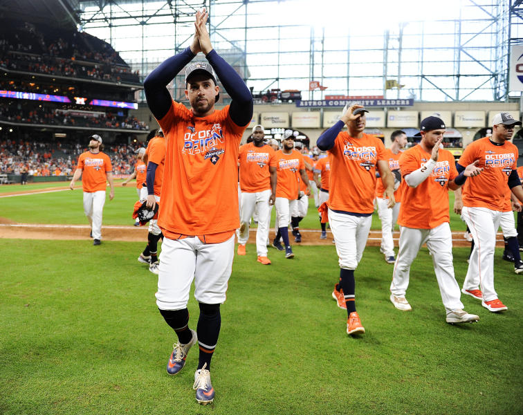 Houston Astros' George Springer, left, celebrates the team's clinching of the AL West crown after a baseball game against the Los Angeles Angels, Sunday, Sept. 22, 2019, in Houston. (AP Photo/Eric Christian Smith)