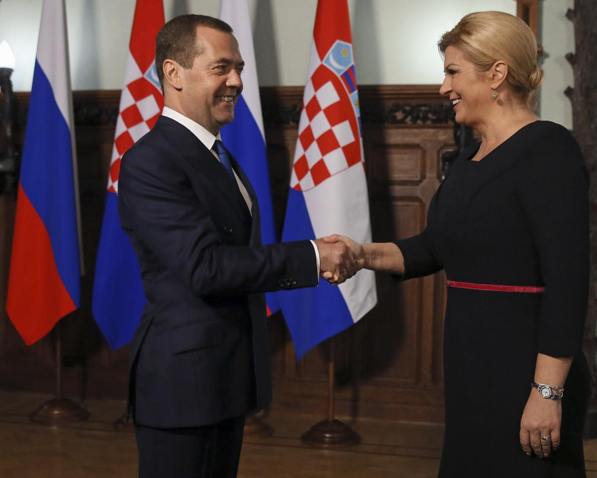 Russian Prime Minister Dmitry Medvedev (L) shakes hands with Croatian President Kolinda Grabar-Kitarovic during a meeting in Moscow, Russia October 19, 2017. Sputnik/Ekaterina Shtukina/Pool via REUTERS  ATTENTION EDITORS - THIS IMAGE WAS PROVIDED BY A THIRD PARTY.