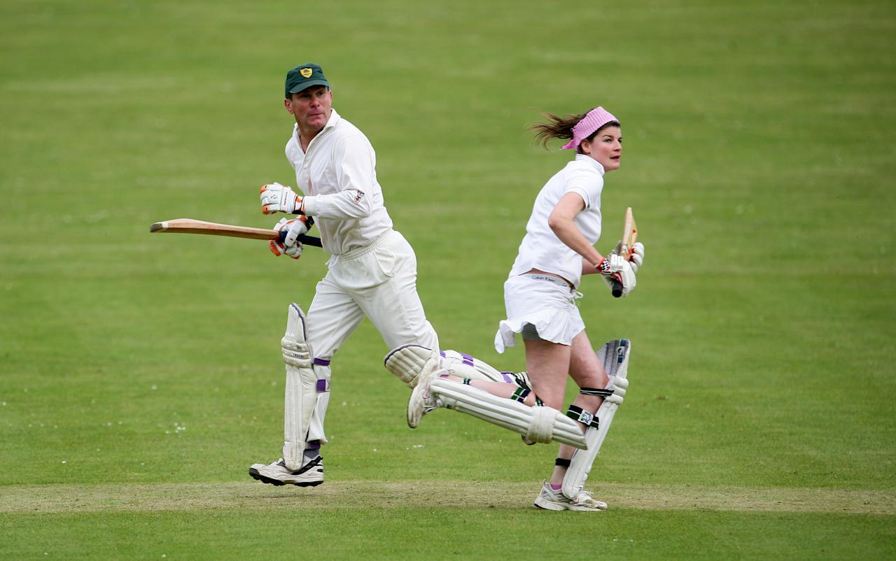 CASTLE ASHBY, ENGLAND - MAY 20: Players run between the wickets during a game of a Village Cricket game being played at Castle Ashby House Cricket Club on May 20, 2007 in Castle Ashby, England.  (Photo by Laurence Griffiths/Getty Images)