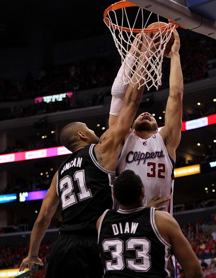 LOS ANGELES, CA - MAY 19: Tim Duncan #21 of the San Antonio Spurs blocks a shot by Blake Griffin #32 of the Los Angeles Clippers in Game Three of the Western Conference Semifinals in the 2012 NBA Playoffs on May 19, 2011 at Staples Center in Los Angeles, California. The Spurs won 96-86 to take a three games to none lead in the series.  NOTE TO USER: User expressly acknowledges and agrees that, by downloading and or using this photograph, User is consenting to the terms and conditions of the Getty Images License Agreement.  (Photo by Stephen Dunn/Getty Images)