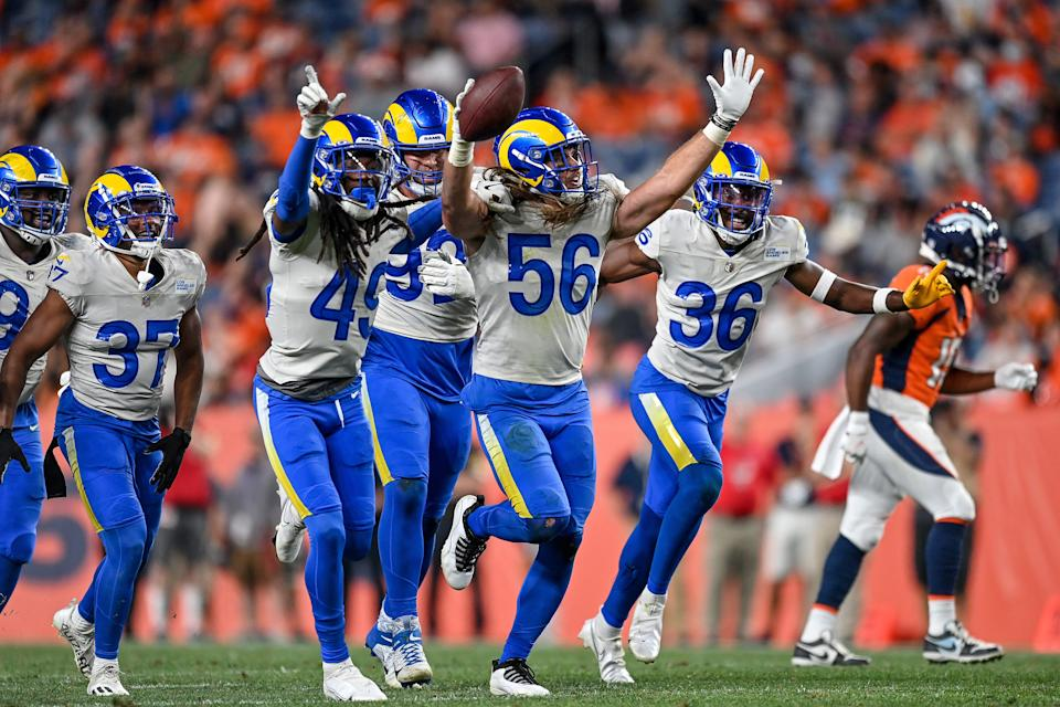 DENVER, COLORADO - AUGUST 28:  Obo Okoronkwo #45, J.R. Reed #36, and Christian Rozeboom #56 of the Los Angeles Rams celebrate after a Rozenboom interception in the fourth quarter during an NFL preseason game at Empower Field at Mile High on August 28, 2021 in Denver, Colorado. (Photo by Dustin Bradford/Getty Images)