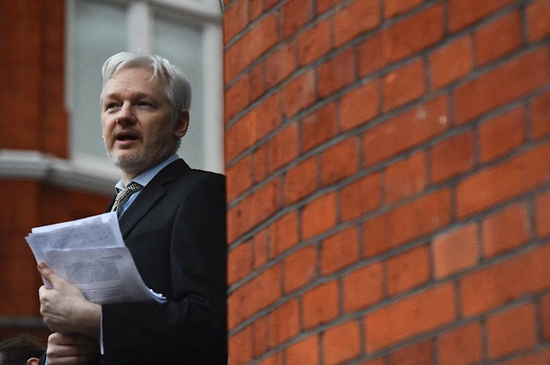 WikiLeaks founder Julian Assange addressing the media from the balcony of the Ecuadorian Embassy in central London in February 2016 (AFP Photo/BEN STANSALL                        )