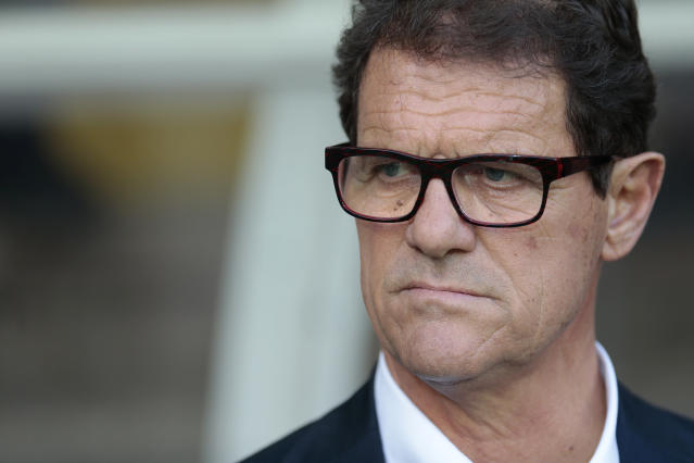 FILE - In this June 14, 2015 file photo, then Russia's coach Fabio Capello watches his players during the Euro 2016 qualifying soccer match between Russia and Austria, in Moscow, Russia. The spending may have slowed but world-famous coaches such as Fabio Capello and Manuel Pellegrini and players like Hulk and Javier Mascherano still have the same objective in the 2018 Chinese Super League that kicks off on Friday: to stop Guangzhou Evergande from winning an eighth consecutive title. (AP Photo/Ivan Sekretarev, File)