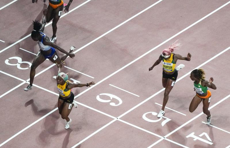 Shelly-Ann Fraser-Pryce, of Jamaica, wins the women's 100 meter finals at the World Athletics Championships in Doha, Qatar, Sunday, Sept. 29, 2019. (AP Photo/Morry Gash)