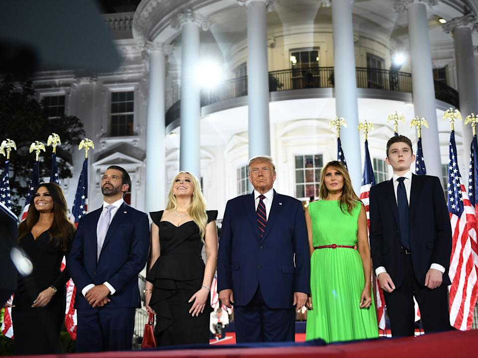 Barron Trump, US First Lady Melania Trump, US President Donald Trump, Tiffany Trump, Donald Trump Jr. and Kimberly Guilfoyle watch fireworks at the conclusion of the final day of the Republican National Convention from the South Lawn of the White House on August 27, 2020 in Washington, DC.