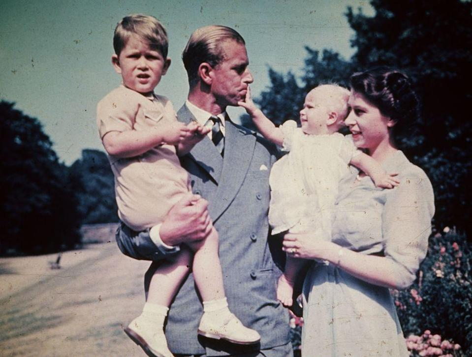 <p>With Queen Elizabeth II and their two children Prince Charles and Princess Anne.</p>