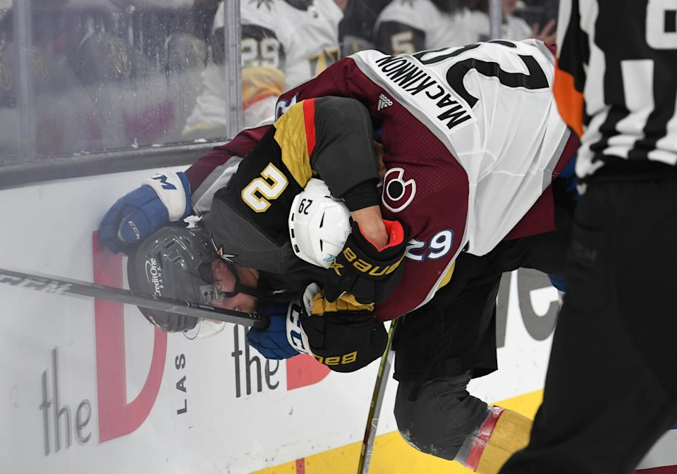 LAS VEGAS, NEVADA - JUNE 10: Nathan MacKinnon #29 of the Colorado Avalanche fights with Zach Whitecloud #2 of the Vegas Golden Knights at the end of the second period in Game Six of the Second Round of the 2021 Stanley Cup Playoffs at T-Mobile Arena on June 10, 2021 in Las Vegas, Nevada. (Photo by David Becker/NHLI via Getty Images)