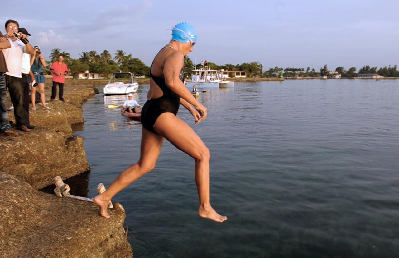 US swimmer Diana Nyad jumps into the water at Ernest Hemingway Nautical Club, in Havana on August 7, 2011, to swim from Havana to Florida in a three-day non-stop journey.  AFP PHOTO/ADALBERTO ROQUE (Photo credit should read ADALBERTO ROQUE/AFP/Getty Images)