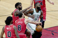 Chicago Bulls' Zach LaVine (8) strips the ball from Boston Celtics' Jaylen Brown (7) as Coby White (0) and Patrick Williams watch during the first half of an NBA basketball game Monday, Jan. 25, 2021, in Chicago. (AP Photo/Charles Rex Arbogast)