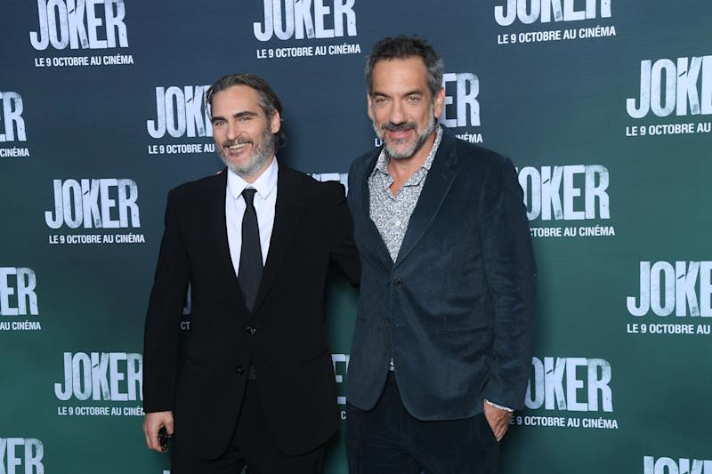 "PARIS, FRANCE - SEPTEMBER 23: (L-R) Actor Joaquin Phoenix and Director Todd Phillips attend the ""Joker"" Premiere at cinema UGC Normandie son September 23, 2019 in Paris, France. (Photo by Stephane Cardinale - Corbis/Corbis via Getty Images)"