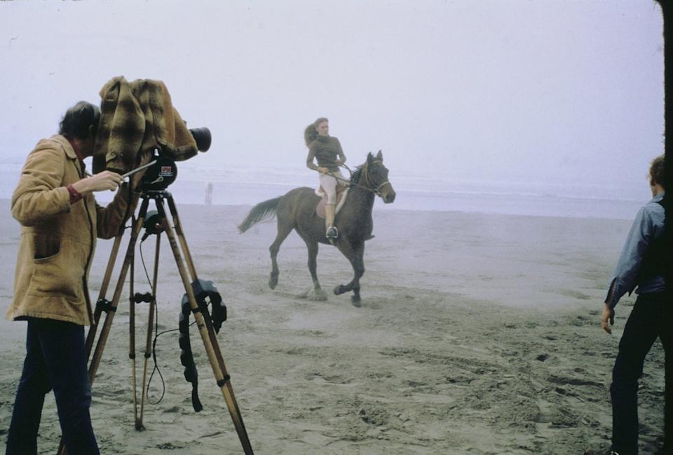 Dennis Muren (behind the camera) filming Suzanne Pasteur (a friend of Lorne Peterson's) on her horse for tauntaun movement reference. (Photo: Lucasfilm)