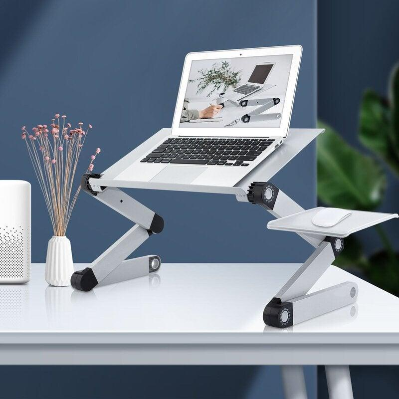 "<h2>RAINBEAN Foldable Portable Adjustable Laptop Cart</h2><br><strong>Best For: Multipurpose</strong><br>According to the product description, this stand can be used as a desk for your bed, a dinner tray, book holder, and more. If you want the most bang for your buck, RAINBEAN has your back.<br><br><em>Shop</em> <strong><em><a href=""https://www.wayfair.com/brand/bnd/rainbean-b60994.html"" rel=""nofollow noopener"" target=""_blank"" data-ylk=""slk:RAINBEAN"" class=""link rapid-noclick-resp"">RAINBEAN</a></em></strong><br><br><strong>RAINBEAN</strong> Foldable Portable Adjustable Laptop Cart, $, available at <a href=""https://go.skimresources.com/?id=30283X879131&url=https%3A%2F%2Fwww.wayfair.com%2Fcommercial-business-furniture%2Fpdp%2Frainbean-foldable-portable-adjustable-laptop-cart-ainb1004.html"" rel=""nofollow noopener"" target=""_blank"" data-ylk=""slk:Wayfair"" class=""link rapid-noclick-resp"">Wayfair</a>"