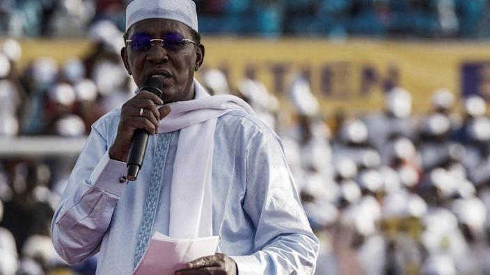 Chadian President Idriss Deby Itno holds his notes as he addresses supporters at his election campaign rally in N'Djamena on April 9, 2021