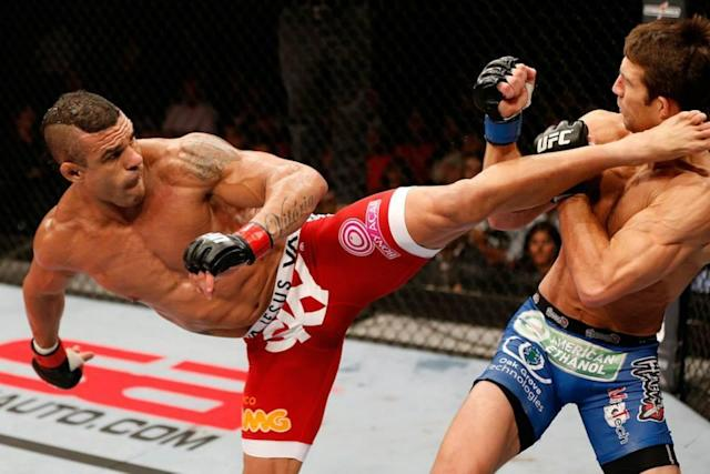 Vitor Belfort [L] has always been lethal with his striking. (Getty)