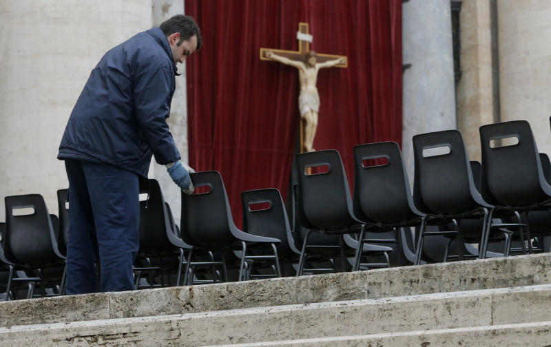 Workers install chairs in St. Peter's Square at the Vatican, Monday, March 18, 2013. The Vatican is releasing details of the pope's installation Mass on Tuesday as well images of his coat of arms and fisherman's ring. In addition to more than 132 government delegations, the Vatican said 33 Christian delegations will be present, as well as representatives from Jewish, Muslim, Buddhist, Sikh and Jain communities. (AP Photo/Dmitry Lovetsky)
