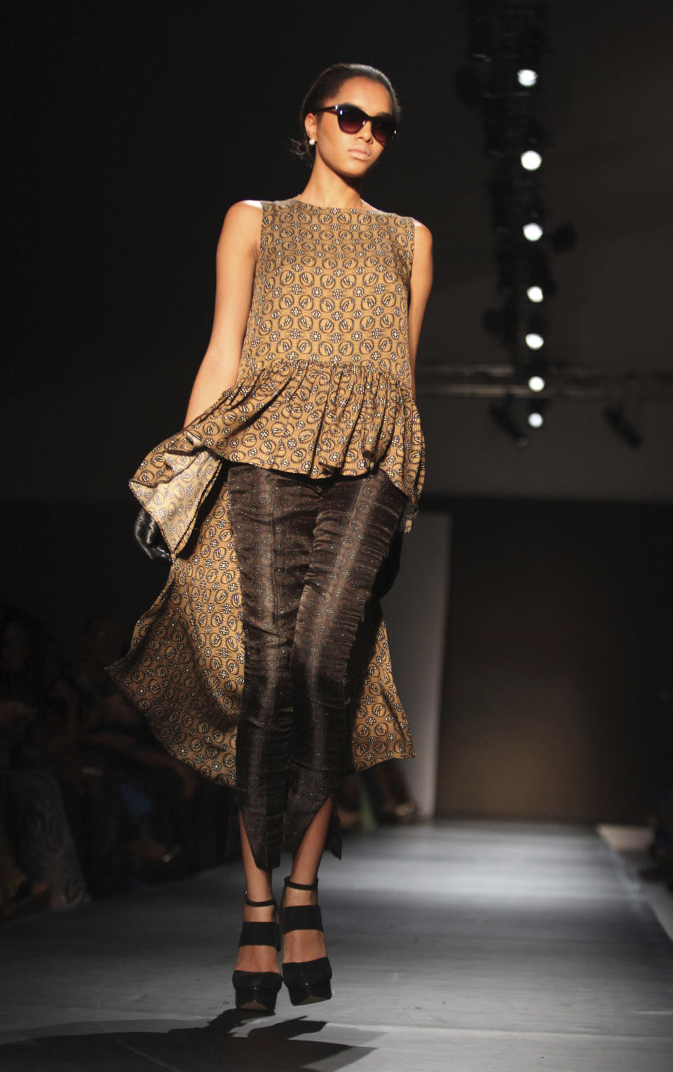A model displays an outfit by designer Jewel by Lisa of Nigeria at the ARISE Fashion Week event in Lagos, Nigeria on Sunday, March 11, 2012. (AP Photos/Sunday Alamba)