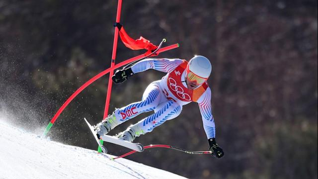 "<p>Travis Lindquist, Senior Director, Editorial Photography, Getty Images Photo - Tom Pennington.<br>Using a long telephoto lens and a fast shutterspeed, Getty Images photographer Tom Pennington was able to capture the incredible speed and control of this skier during the Men's Alpine Downhill <br>Combined. Seeing the gate contorted after the skier hit it at nearly 100km per hour and still maintaining his form, control, and concentration is a testament to skill these athletes have and the <br>talent the photographer has to capture everything in this split second.</p><p>Our photographers covering the Alpine skiing are facing extreme temperatures, their day on the mountain often begins before sun up in an effort to scout the course to find the best shooting location with the given course set or gate placement. The gates change for the Downhill and Super G, so the photo positions often need to be changed around.</p><p>In addition to scouting on course, they are constantly scanning outside the A-net and B-net fencing for possible off course photo positions and Alpine is one of the only sports where they are required to be in their shooting position one hour before competition/training begins and they cannot move from these positions.</p><p>These photo positions are often no larger than 10""X3"", so there is very little room to move around to stay warm – very challenging!</p>"
