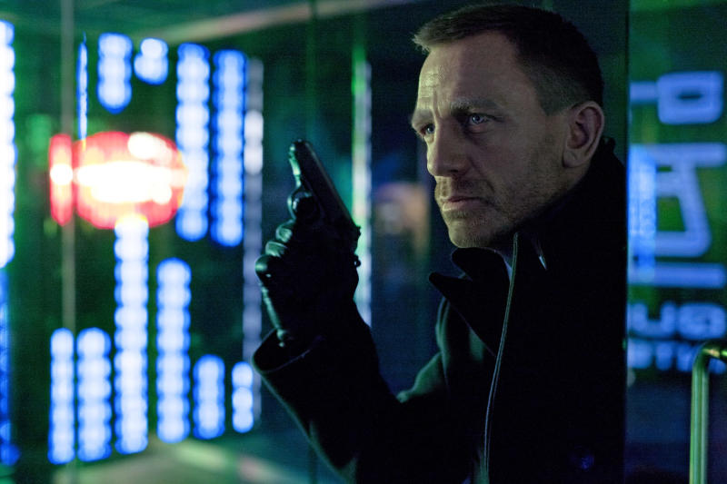 "FILE - This undated file photo released by Columbia Pictures shows Daniel Craig as James Bond in the action adventure film, ""Skyfall.""  According to studio estimates Sunday, Dec. 9, 2012, ""Skyfall"" took in $11 million to move back to No. 1 in its fifth weekend.  That puts it narrowly ahead of ""Rise of the Guardians,"" the animated adventure of Santa, the Easter Bunny and other mythological heroes that pulled in $10.5 million.(AP Photo/Sony Pictures, Francois Duhamel, File)"
