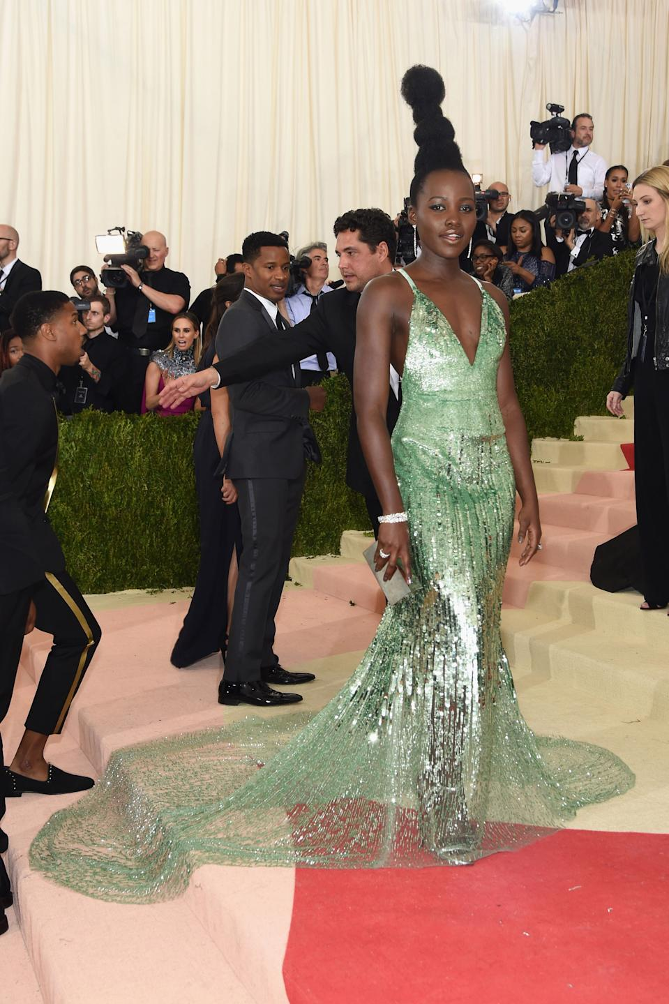 """<h1 class=""""title"""">Lupita Nyong'o in a Calvin Klein Collection dress, Tiffany & Co. jewelry, and Jimmy Choo shoes</h1><cite class=""""credit"""">Photo: Getty Images</cite>"""