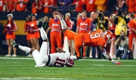 Jan 11, 2016; Glendale, AZ, USA; Clemson Tigers running back Wayne Gallman (9) is tackled by Alabama Crimson Tide linebacker Reuben Foster (10) in the second quarter in the 2016 CFP National Championship at University of Phoenix Stadium. Mandatory Credit: Mark J. Rebilas-USA TODAY Sports / Reuters Picture Supplied by Action Images (TAGS: Sport American Football NCAA) *** Local Caption *** 2016-01-12T032122Z_714498906_NOCID_RTRMADP_3_NCAA-FOOTBALL-CFP-NATIONAL-CHAMPIONSHIP-ALABAMA-VS-CLEMSON.JPG
