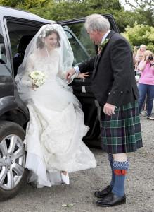"Actress Rose Leslie is escorted by her father Sebastian as they arrive for her wedding at Rayne Church, Kirkton of Rayne in Aberdeenshire, Scotland, Saturday June 23, 2018. Former ""Game of Thrones"" co-stars Kit Harington and Rose Leslie are marrying Saturday with a celebration at the bride's family castle in Scotland. The couple and guests arrived at Rayne Church, close to the 900-year-old Wardhill Castle in northeast Scotland, which is owned by Leslie's family. (Jane Barlow/PA via AP)"
