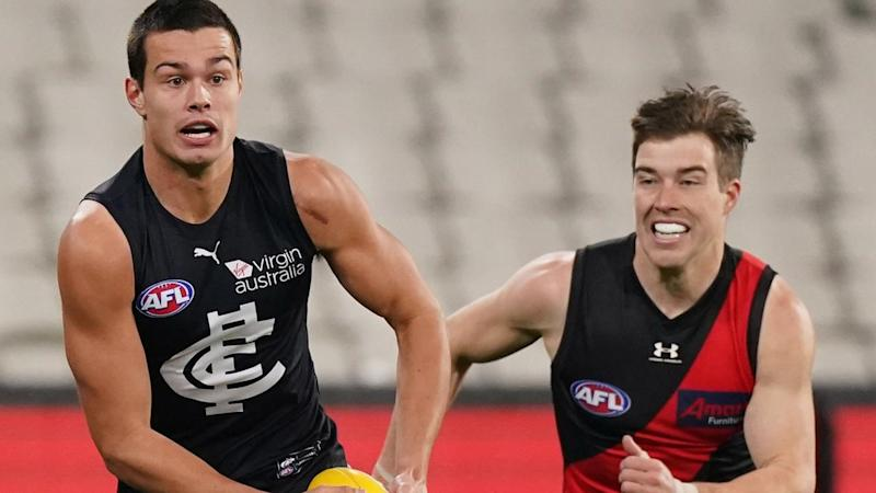 Carlton's Jack Silvagni (L) is in hospital after copping a blow during the Essendon AFL clash
