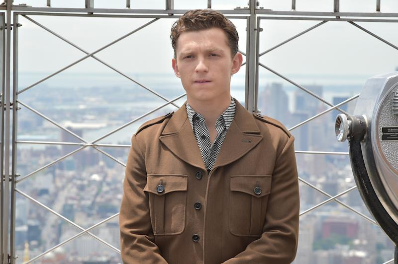 "NEW YORK, NEW YORK - JUNE 24: Tom Holland attends Stars Of ""Spider-Man: Far From Home"" Light The Empire State Building at The Empire State Building on June 24, 2019 in New York City. (Photo by Theo Wargo/Getty Images)"