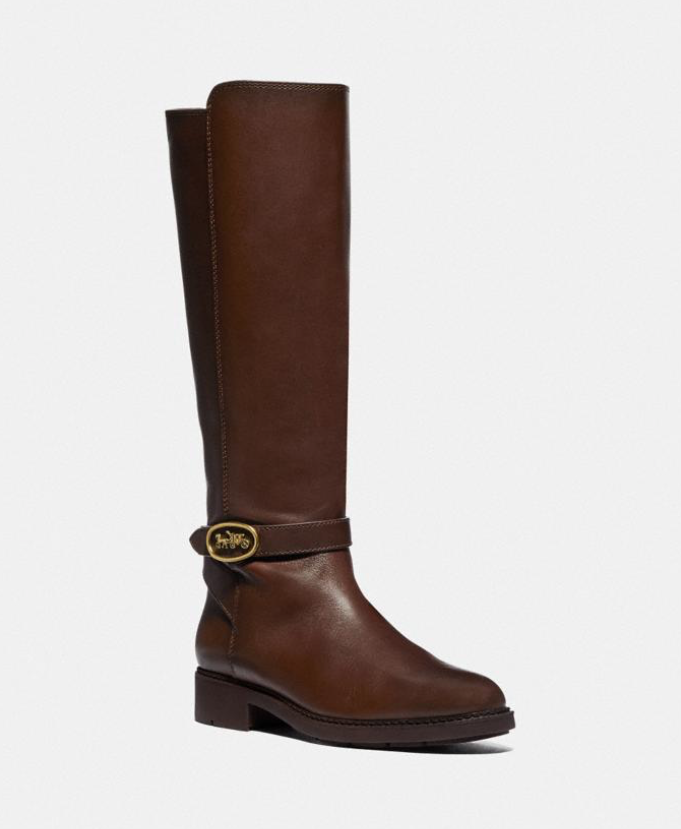 Upgrade your shoe collection with a pair of beautiful fall boots. (Photo: Coach)