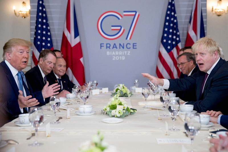 President Donald Trump said Mr Johnson was the 'right man to deliver Brexit' at a working breakfast during the G7 (AP)