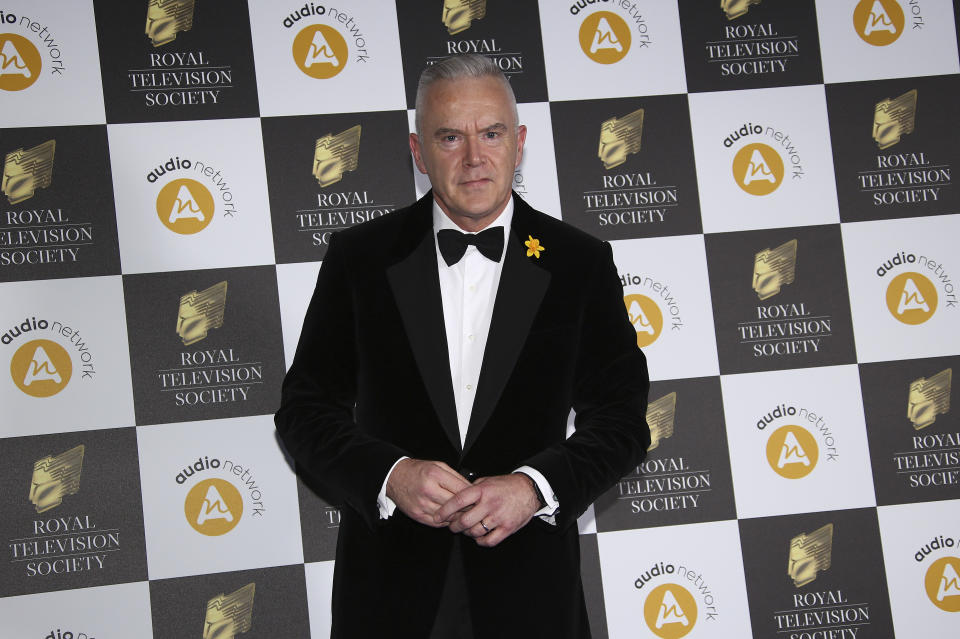 Huw Edwards poses for photographers upon arrival for a the Royal Television Society Awards in central London, Tuesday, Mar 19, 2019. (Photo by Joel C Ryan/Invision/AP)