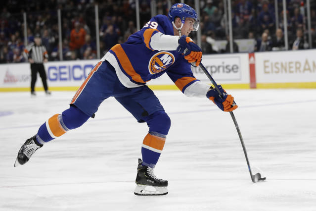 New York Islanders' Brock Nelson (29) shoots on goal during the second period of an NHL hockey game against the Nashville Predators Tuesday, Dec. 17, 2019, in Uniondale, N.Y. Nelson scored on the play. (AP Photo/Frank Franklin II)