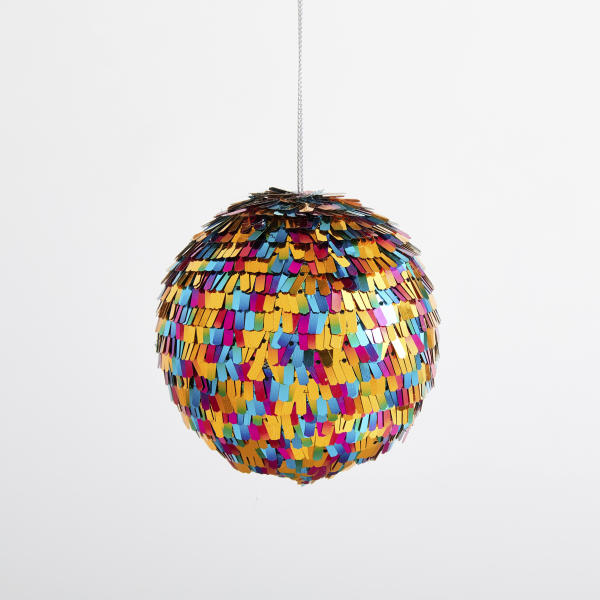 This undated photo shows West Elm's playful Fringe Disco Ball, which is covered in brightly-hued metallic confetti. (West Elm via AP)