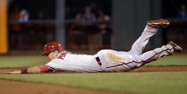 Arizona Diamondbacks' Cliff Pennington steals second base against the San Francisco Giants during the 10th inning of a baseball game on Thursday, April 10, 2014, in San Francisco. Pennington would then score the go-ahead run on a single by Tony Campana. Arizona won 6-5. (AP Photo/Marcio Jose Sanchez)