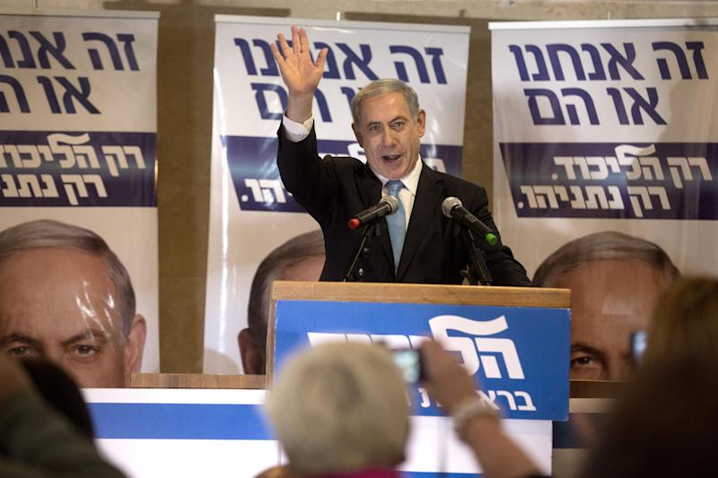 Israeli Prime Minister and Likud party leader Benjamin Netanyahu waves as he delivers a speech during an election campaign meeting at a Jerusalem hotel on February 8, 2015