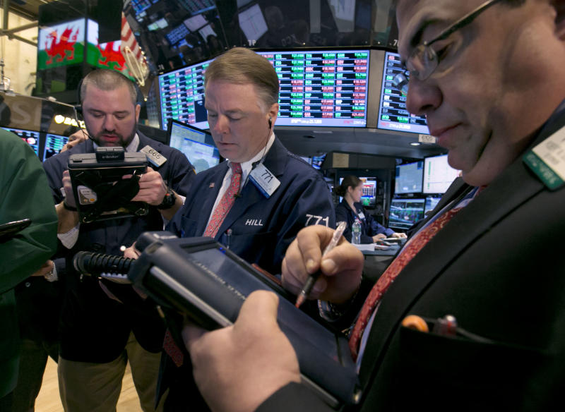 Traders work on the floor of the New York Stock Exchange, Friday, Feb. 28, 2014. U.S. stocks are opening higher, pushing the market further into record territory. (AP Photo/Richard Drew)