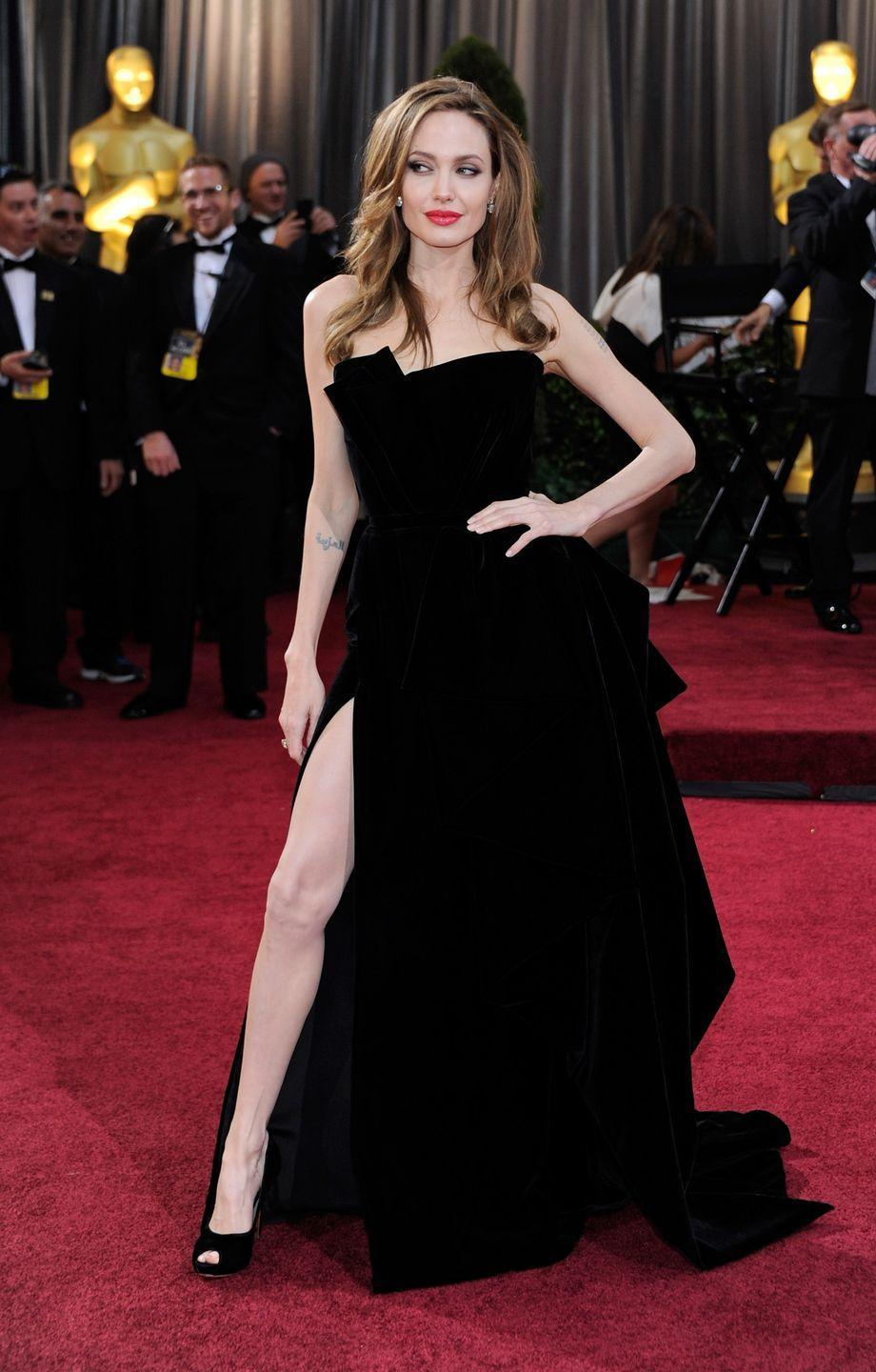 <p>One of the most famous Oscar red-carpet moments of all time - not necessarily thanks to the dress, but for the pose that accompanied it. When Angelina Jolie stepped out at the 2012 Academy Awards in this dramatic Versace gown, she showed off the thigh-high split to full effect by strategically posing with her leg peeking out from the side just so. Little did she know that her leg would send the internet into a frenzy, spawning countless memes and featuring highly on talk shows and websites the following day. </p>