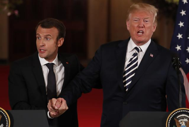 <p>French President Emmanuel Macron clasps hands with U.S. President Donald Trump at the conclusion of their joint news conference in the East Room of the White House in Washington, April 24, 2018. (Photo: Jonathan Ernst/Reuters) </p>