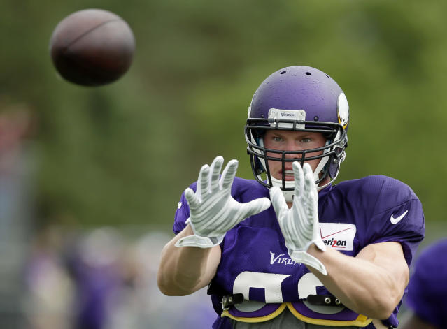 Minnesota Vikings tight end Kyle Rudolph catches a pass during NFL football training camp, Sunday, July 27, 2014, in Mankato, Minn. (AP Photo/Charlie Neibergall)