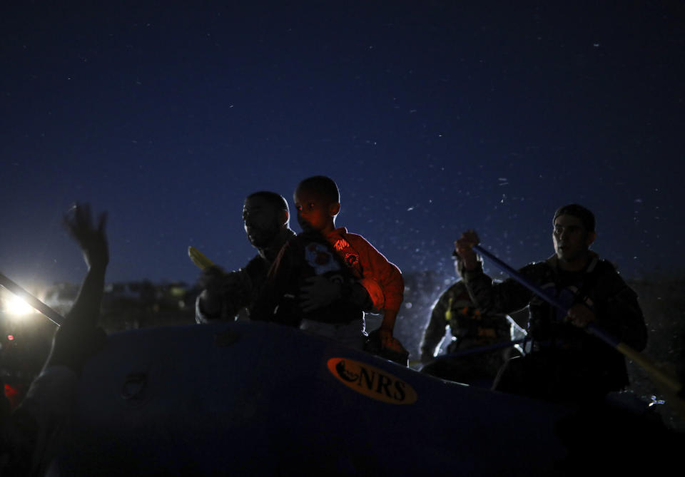 United States agents rescue a migrant child from the waters of the Rio Grande after his parents lost their footing and the children began to be swept away by the current on the American side of the border between Ciudad Acuña, Mexico, and Del Rio, Texas Thursday, Sept. 23, 2021. (AP Photo/Felix Marquez)