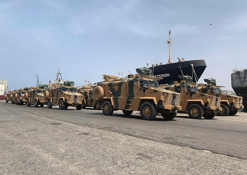 "A photo posted on the Facebook Page of the media bureau of ""Volcano of Anger"" operation on May 18, 2019, reportedly shows Turkish-made armoured personnel vehicles, shipped to Libya's internationally recognised Government of National Accord (GNA), arriving at Tripoli port.GNA forces are currently battling fighters from commander Khalifa Haftar's self-styled Libyan National Army, which launched an offensive on April 4 to take the capital. The GNA said the new weaponry had been supplied ""in preparation for a vast operation to annihilate the rebels of the war criminal, the rebel Haftar."" (AFP Photo/-)"