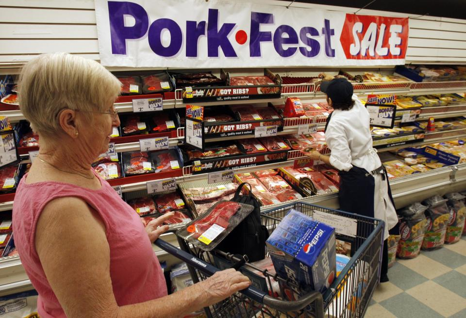Patricia Sermeno, right, an Albertsons butcher chop employee, stacks meat at the Albertsons supermarket in Glendale, Calif., Monday April 28, 2008. The tax rebates starting to show up in Americans' mailboxes and bank accounts will likely be used for food and other basic necessities, making them less of an economic stimulus than the Bush administration hoped for.(AP Photo/Kevork Djansezian)