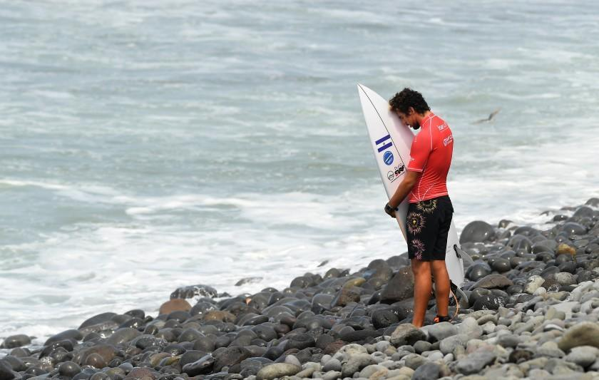 -SP-June 4, 2021: Surfer Bryan Perez prays before competing in the Surf City El Salvador ISA World Surfing Games. (Wally Skalij / Los Angeles Times)