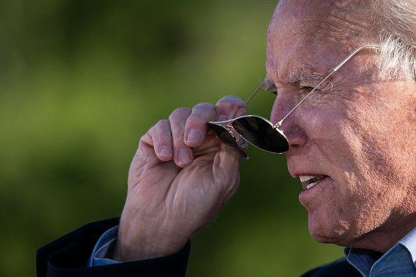 <p>Biden puts on his sunglasses while speaking at a campaign stop at Community College of Beaver County on November 2, 2020—one day before the election—in Monaca, Pennsylvania.</p>