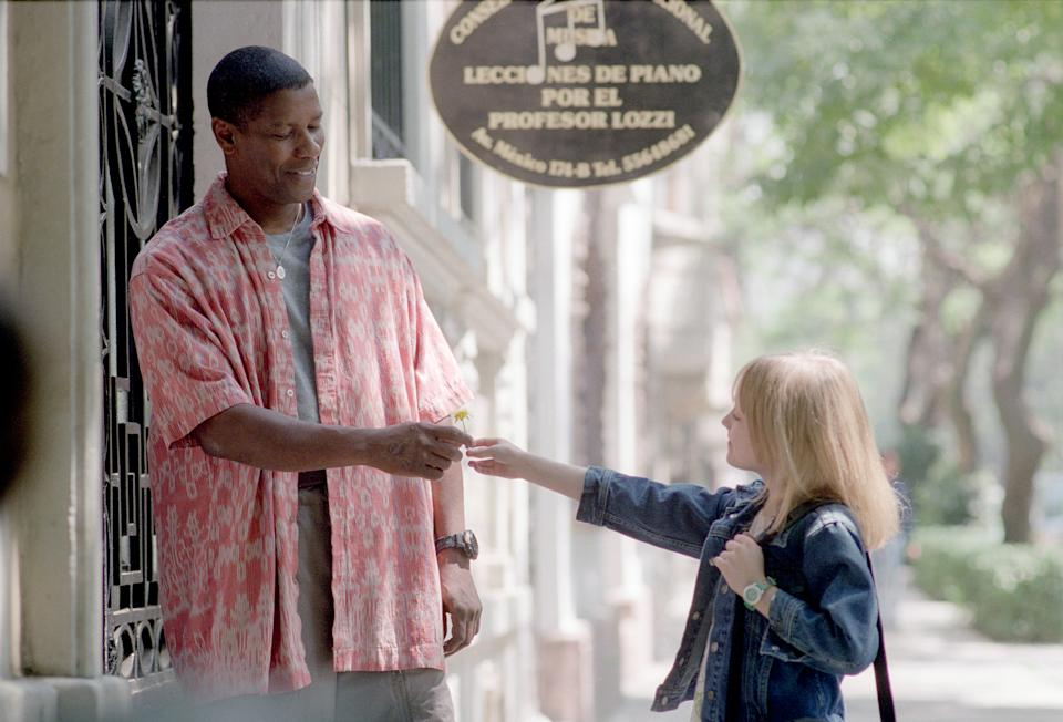 American actors Denzel Washington and Dakota Fanning on the set of Man of Fire, directed and produced by Tony Scott. (Photo by Twentieth Century Fox/Regency/Sunset Boulevard/Corbis via Getty Images)