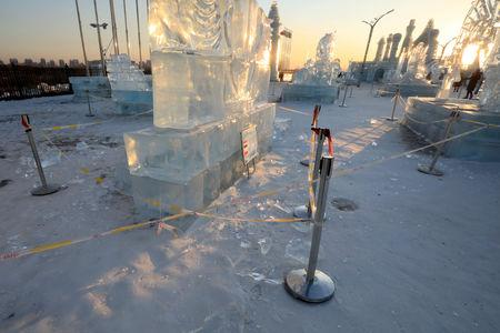 Security lines are seen set up for protecting visitors from falling ice from melting ice sculptures at the venue of the Harbin International Ice and Snow Sculpture Festival on its closing day, in Heilongjiang province, China February 17, 2019. Picture taken February 17, 2019. REUTERS/Stringer