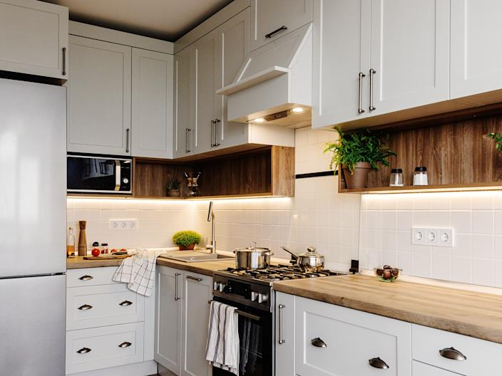 kitchen white cabinets wood counters