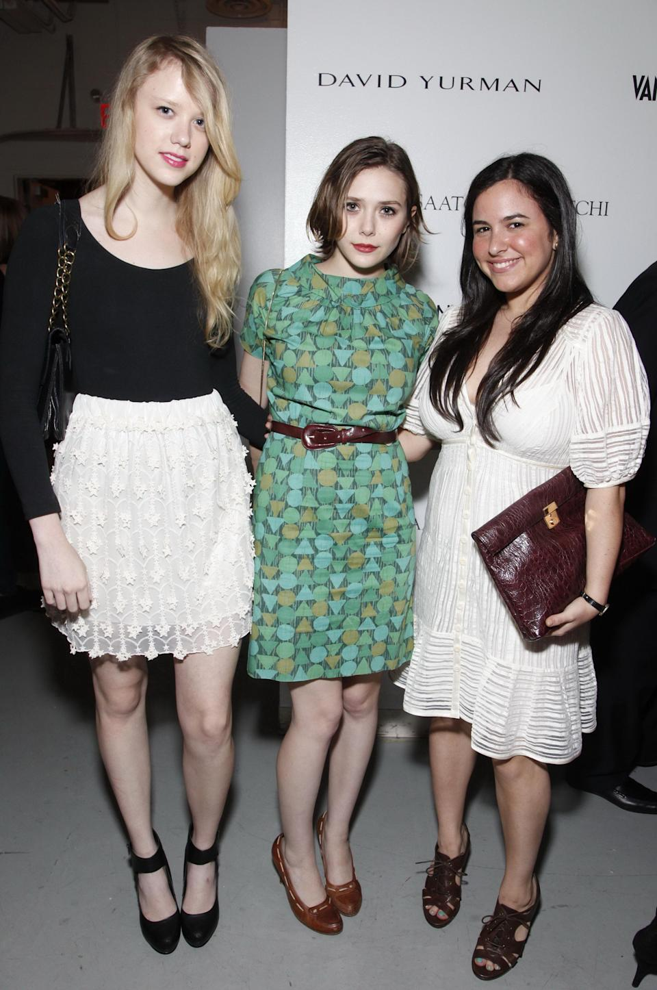 Lauren Lucas, Olsen (center) and Rebecca Dorfman at the Free Arts NYC art auction benefit in New York City on May 14, 2010.