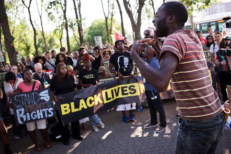 Desmond Cole addresses the crowd gathered at a Black Lives Matter protest on GIilbert Avenue in Toronto, where Andrew Loku was shot dead by police. (Photo: Melissa Renwick via Getty Images)