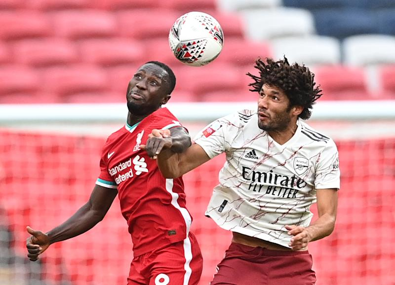 Soccer Football - FA Community Shield - Arsenal v Liverpool - Wembley Stadium, London, Britain - August 29, 2020 Arsenal's Mohamed Elneny in action with Liverpool's Naby Keita, as play resumes behind closed doors following the outbreak of the coronavirus disease (COVID-19) Pool via REUTERS/Justin Tallis
